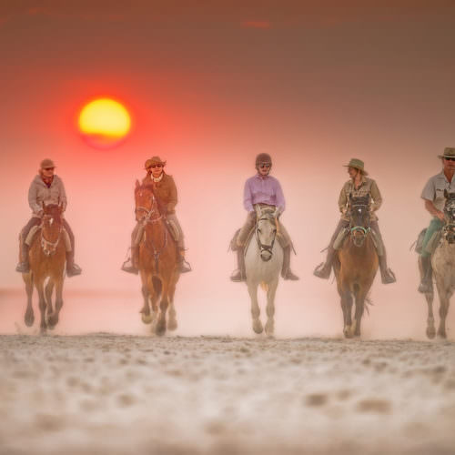 The Kalahari Riding Safari in the Makgadikgadi salt pans of Botswana. Horses at sunset.