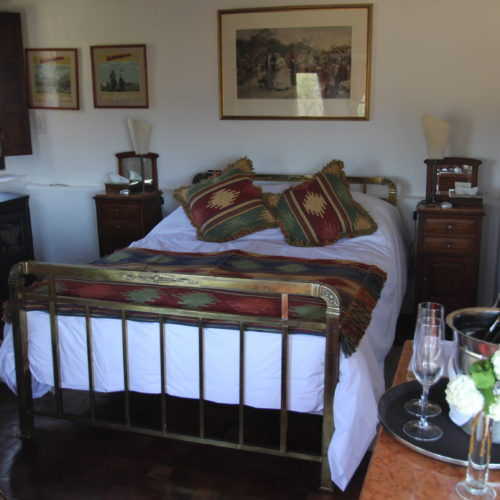 Honeymoon cottage. Traditional bedroom in Argentina. Estancia Los Potreros