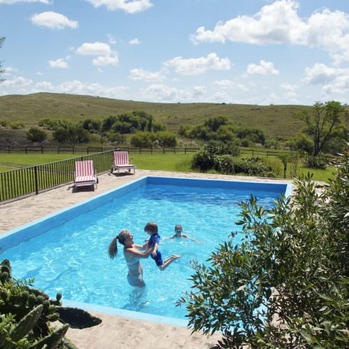 Having fun in the swimming pool at Estancia Los Potreros, Argentina.