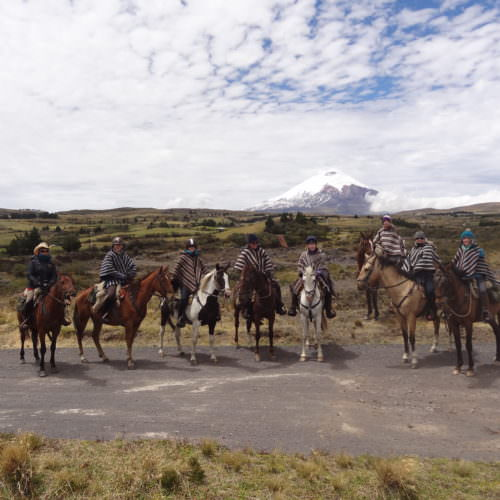 Riders next to Cotopaxi Volcano