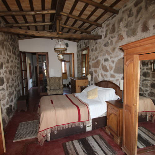 Spacious accommodation. Traditional bedroom at Estancia Los Potreros, Argentina. Riding Holidays with In The Saddle.