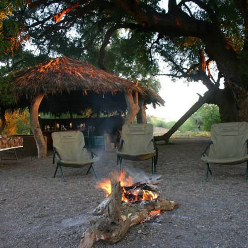 Tuli Trail mobile horseback safari holiday. Riding in Botswana. Bush camp. Campfire.