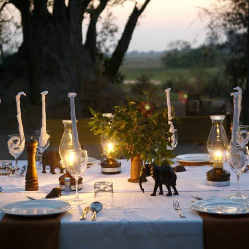 In The Saddle. Riding Safari at Macatoo, Okavango Delta, Botswana. Luxury Bush Camp - dining.