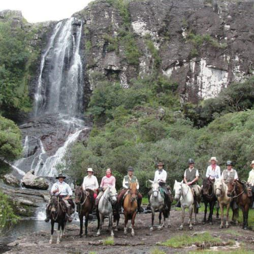 Riding Holidays in Brazil. Trail riding vacation. Horses by the waterfall