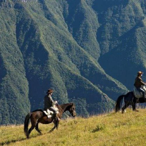 Riding Holidays in Brazil. Trail riding vacation. Horses by a canyon.
