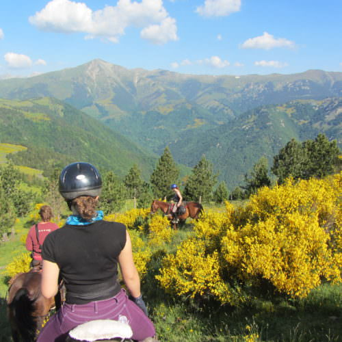 Adventurous trail riding holiday through the Pyrenees Mountains, Spain. Horse, spectacular views, blue skies.