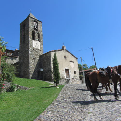 Adventurous trail riding holiday through the Pyrenees Mountains, Spain. Horses, medieval village