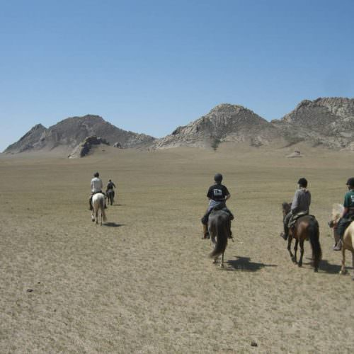 Mongolia riding in rocks