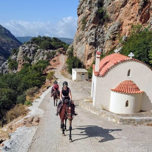 Riding past a church in the mountains in Crete